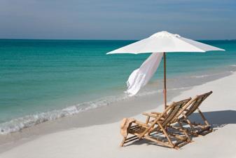 chairs and an umbrella on a beach